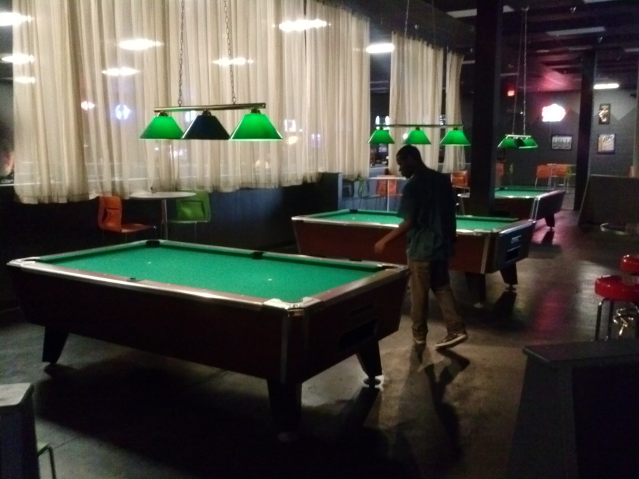 The primary billiards area, placed near the arcade and bowling alley.